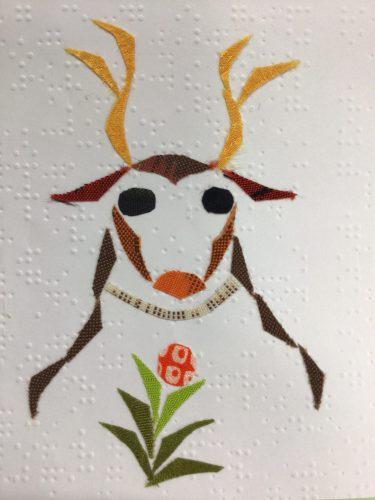 点字用紙に古布でトナカイをデザイン